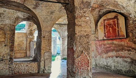 Gaze on colourful ancient frescoes in Ostia Antica