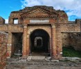 Learn about Ostia's role at the centre of ancient trade in amazing buildings like the Horrea Epagathiana - a storehouse for valuable goods