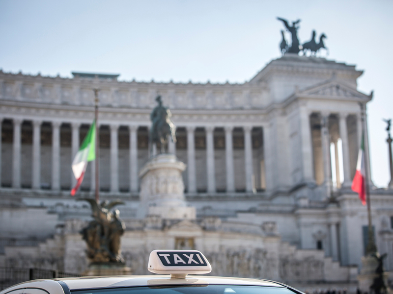Rent white legal taxi in Rome