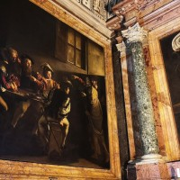 Be transported back to the world of 17th century Rome in Caravaggio's stunning Calling of Saint Matthew