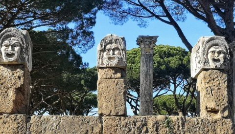 Gaze on amazing sculptures of classical theatrical masks in Ostia's theatre